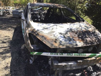 One of the burnt-out vehicles.
