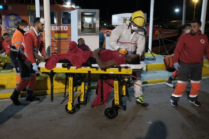 A migrant is taken to hospital after arriving at the port of Melilla.