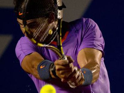 Rafael Nadal of Spain hits a return to Diego Sebastian Schwartzman of Argentina at the Mexico ATP Open.