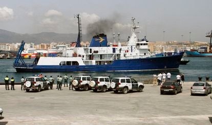 """Spanish Civil Guard officers watching the """"Ocean Alert,"""" a vessel owned by Odyssey Marine Explorations, near Gibraltar in 2007."""