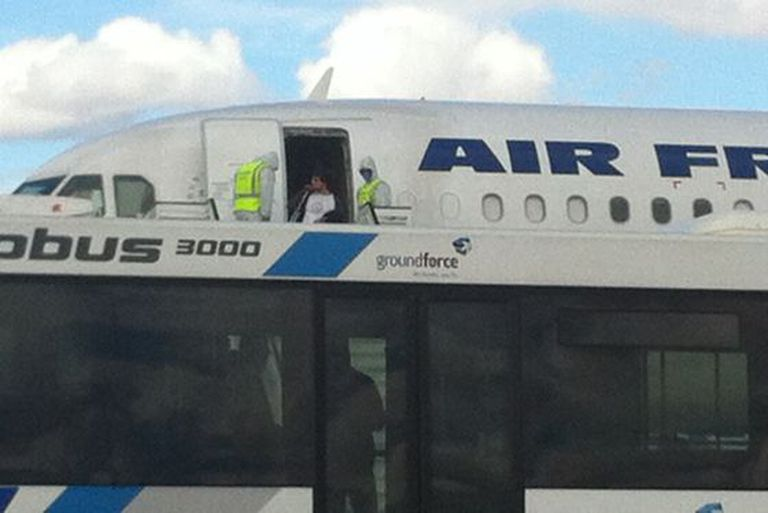 Passengers are disembarked from the Air France flight.