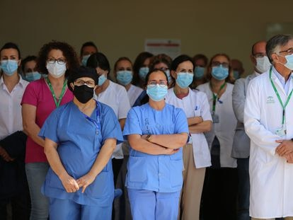 Health workers in Málaga observe a minute of silence for the victims of coronavirus in Spain.