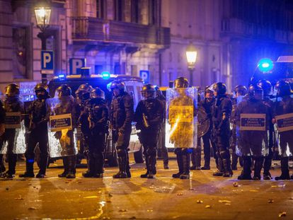 Police officers at street protests in Barcelona last month.