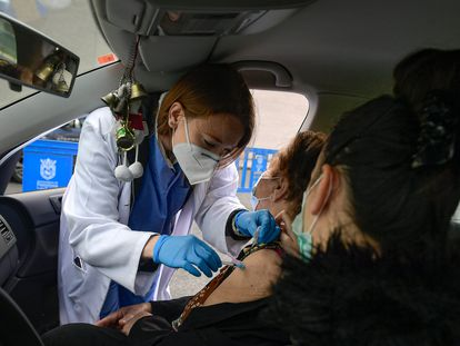 An 88-year-old woman getting her first vaccine dose in Pamplona.