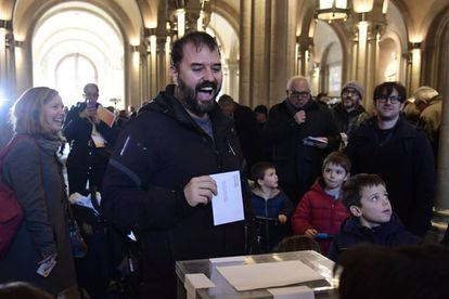 A man casts his ballot for the Catalan regional election at a polling station in Barcelona.