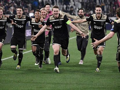 Ajax players celebrate moving onto the semifinals.