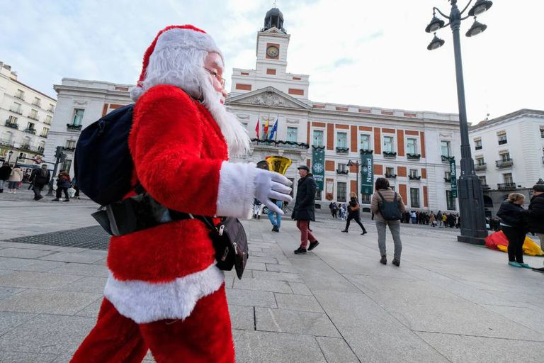 A man dressed as Santa in Madrid's Puerta del Sol.