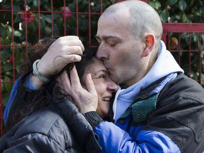 David Reboredo hugs his girlfriend after his release Monday.