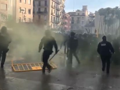 Catalan police charge at protesters in Girona.