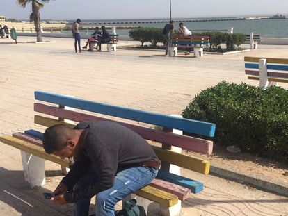 A young man on the seaside promenade in Dakhla.