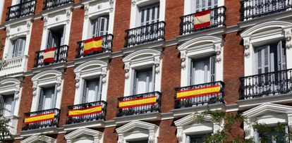 Spanish flags on display on Madrid buildings.