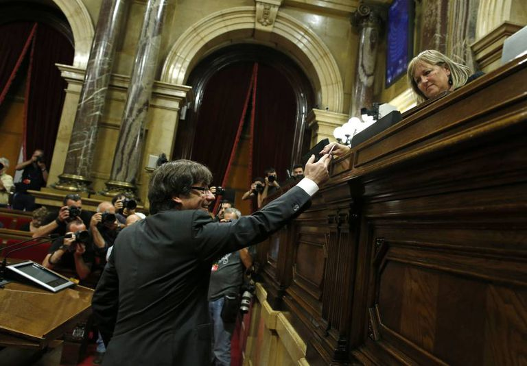 Catalan premier Carles Puigdemont casts his ballot on Friday.