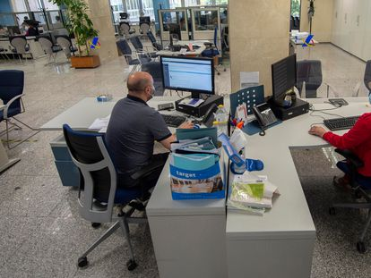 Masked workers at a tax office in Madrid, on July 27.
