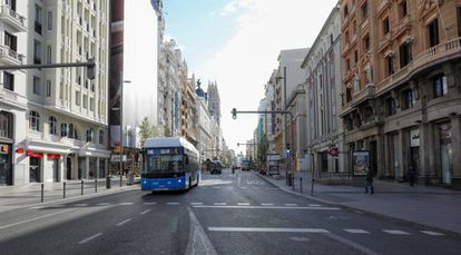 Madrid's Gran Vía, normally a hub of activity, is largely deserted due to the lockdown.
