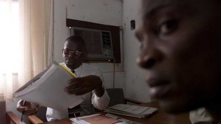 Dr. Wole Daini, who has AIDS, at his surgery in Lagos.