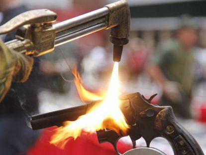 An illegal gun being melted down in Venezuela.