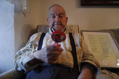 Martín de la Torre holds the rattle that his mother took with her to the grave in September 1936.