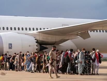 Afghan refugees arrive at the Torrejón de Ardoz airbase in Madrid on Monday.