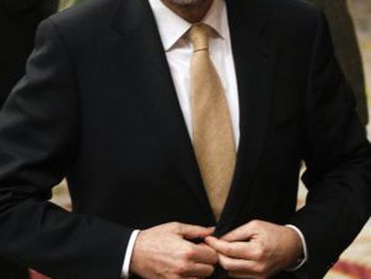 Spain's Prime Minister Mariano Rajoy leaves a parliamentary session.