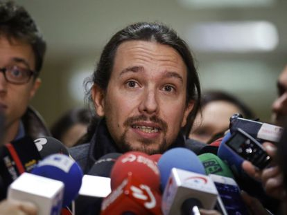 Podemos leader Pablo Iglesias talks to reporters in Madrid on Monday.
