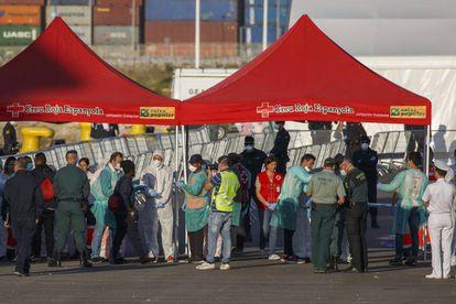 Migrants are checked as they disembark from the Italian coast guard vessel 'Dattilo.'