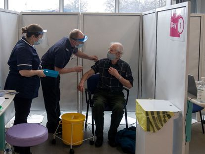 A 67-year-old man receives the Oxford-AstraZeneca vaccine in Britain.