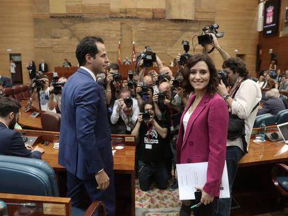 Isabel Díaz Ayuso, of the PP, and Ciudadanos regional leader Ignacio Aguado.
