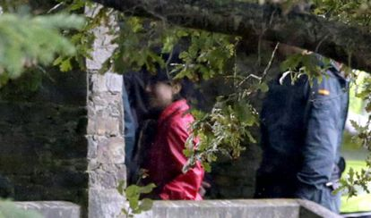 Rosario Porto (left) during a search conducted of her family's property in Teo, Santiago on Friday.