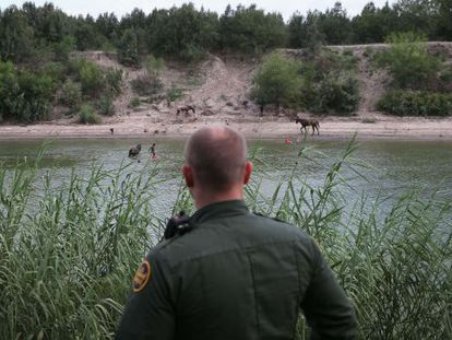 An officer on patrol along the US-Mexico border in Texas.