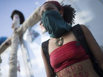 A protestor defending sexual liberties and right to an abortion demonstrates during the recent papel visit in Rio de Janeiro.