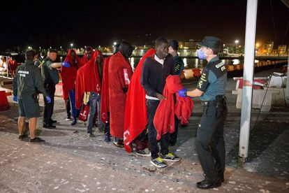 Migrants arriving at the port of Motril.