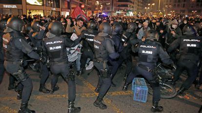 Riot police clash with protesters in Valencia.