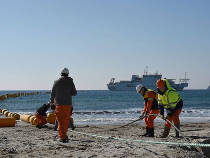 Orange Marine workers install an underwater cable between Singapore and France in March 2016.