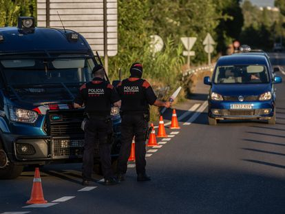 Two Catalan regional police officers control access to the A2 highway into Barcelona.  06/07/2020