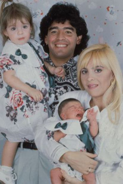 A photo of Maradona and his former wife with their two daughters.