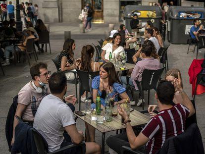 A sidewalk café in Santa Ana square in Madrid.