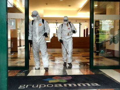 Members of the Emergency Military Unit (UME) disinfecting a care home in Madrid in March 2020.