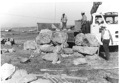 Workers load the stones of the Talaiotic sanctuary at Son Oms in the late 1960s.