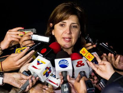 Colombian Foreign Minister Ángela Holguín speaks to reporters.