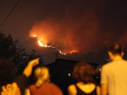 Flames rising above a church in Vigo.