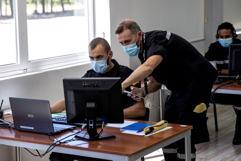 Military members help with coronavirus contact tracking in Spain.