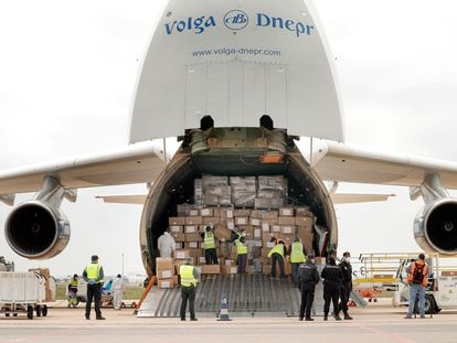 A plane carrying 65 tons of medical supplies from China lands at Manises airport in Valencia.
