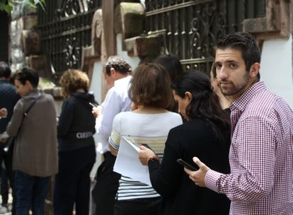 A man lines up in Mexico City to request Spanish nationality ahead of the September 30 deadline in 2019.