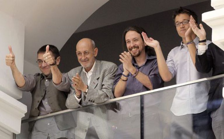 Podemos members (from left to right) Juan Carlos Monedero, Jesús Montero, Pablo Iglesias and Íñigo Errejón applaud the investiture of Manuela Carmena.