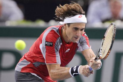 David Ferrer returns the ball to Jerzy Janowicz of Poland during their final match on Sunday in Paris.