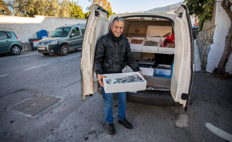 José Manuel Aguilar sells fresh fish from his van in the village of Lecrín.
