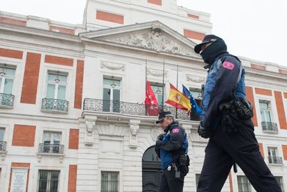 Flags at half mast at a regional government building in Madrid.