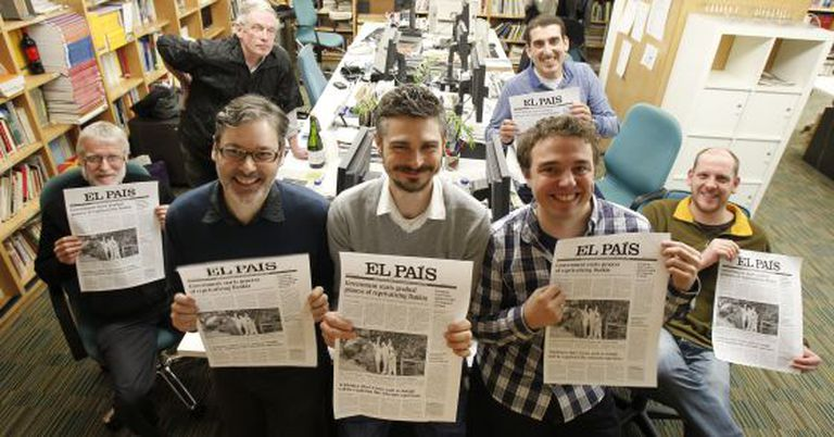 The team behind the EL PAÍS ENGLISH EDITION, pictured with the proofs of the last print issue.
