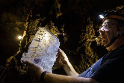 José Ángel Solanilla, a mining engineer, holds up gypsum crystal found inside Mina Rica.
