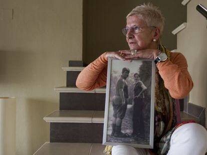 Maixabel Lasa, whose husband was killed by ETA hitmen, poses with a photo of the couple when they were 16 years old.